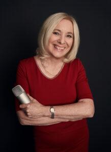 Woman with microphone on radio show